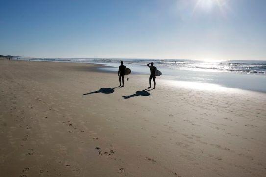 Surfers on Coolum Beach